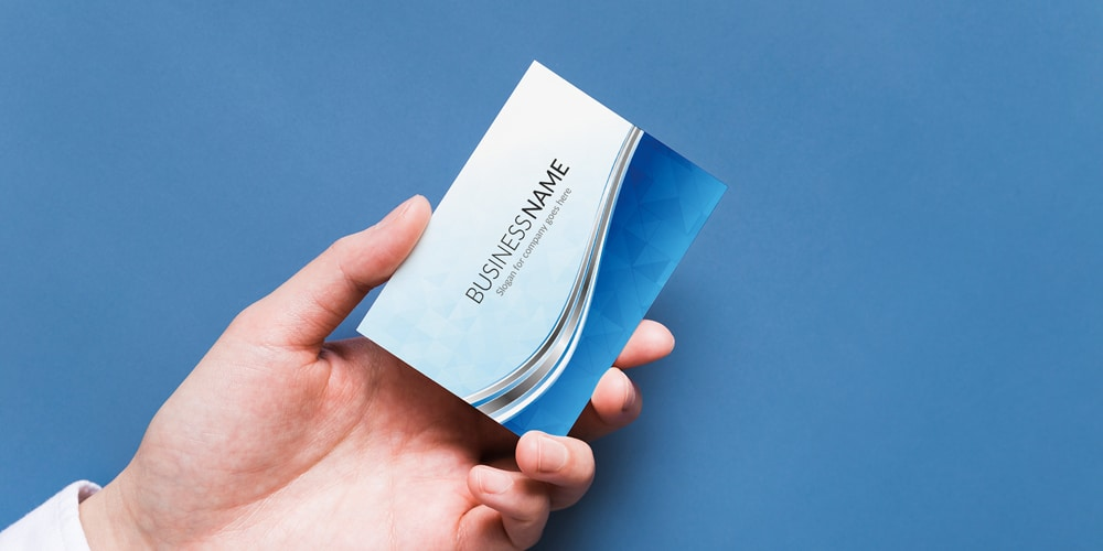Man Holding Business Card Mockup Template