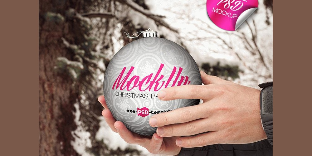 Free Christmas Ball Hand Hold Mockup PSD