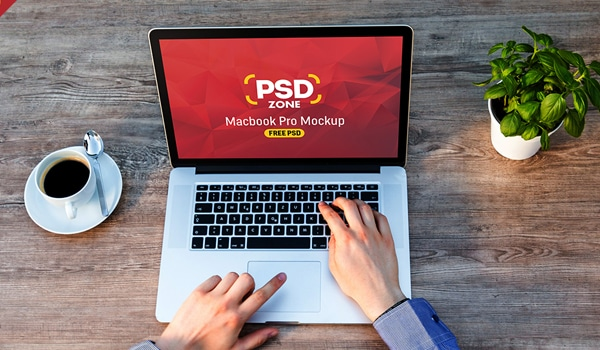Man Working on Macbook Mockup Free PSD