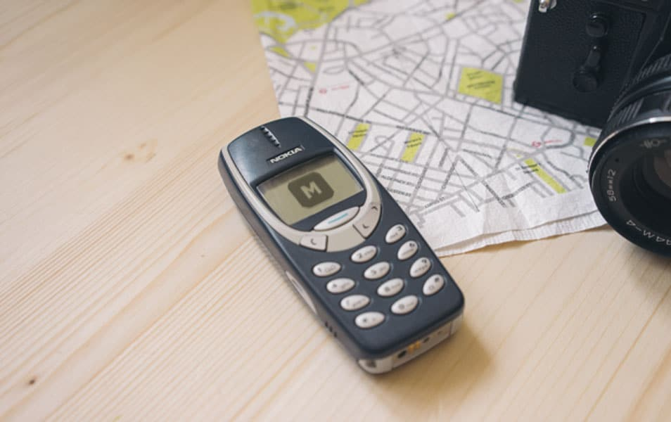 Nokia 3310 on a Wooden Desk