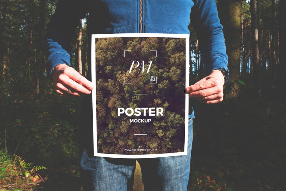 Man in Forest Holding Poster Mockup PSD