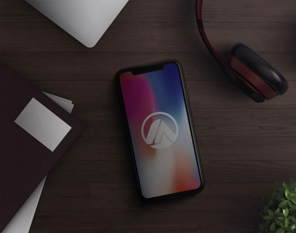 iPhone X in Desk Mockup PSD