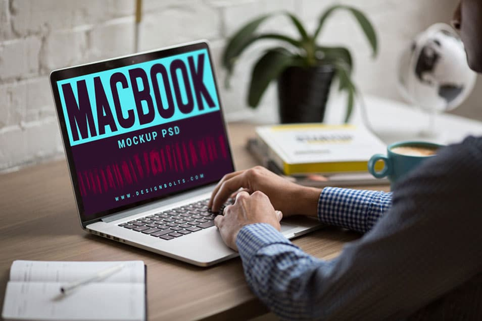 Free MacBook on Office Table Photo Mockup PSD