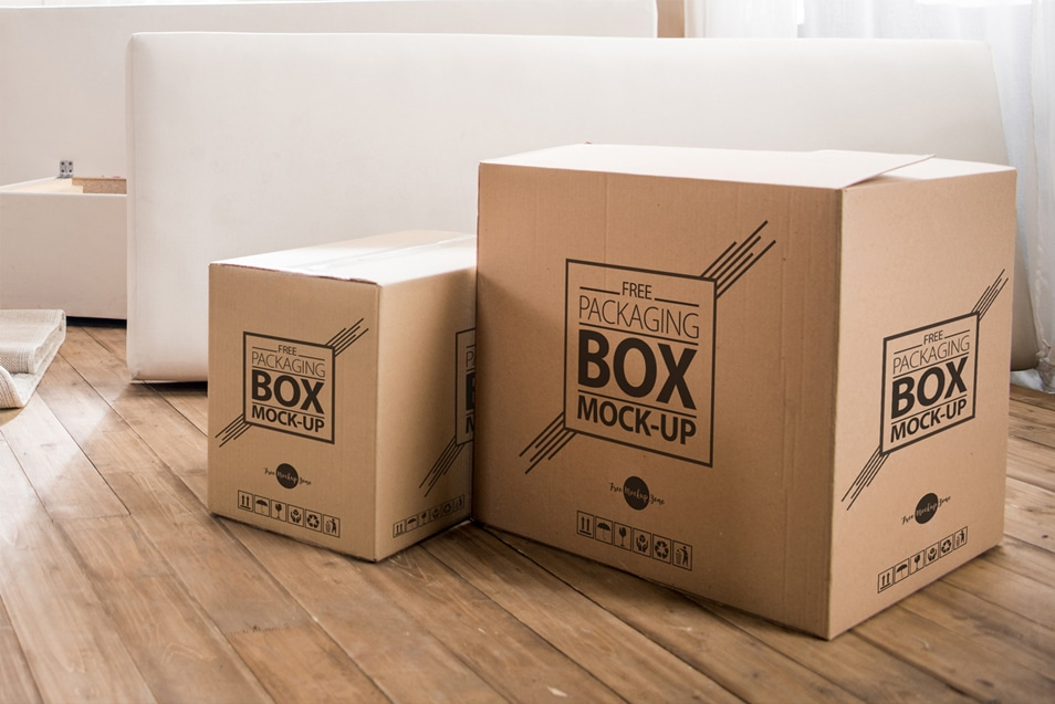Free Packaging Box on Wooden Floor PSD Mockup