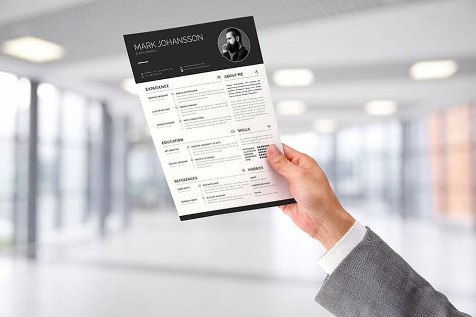 Free A4 Resume / Letterhead Paper in Male Hand Mockup PSD