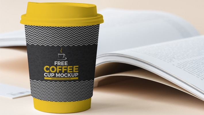 Free Coffee Cup Beside Book Mockup