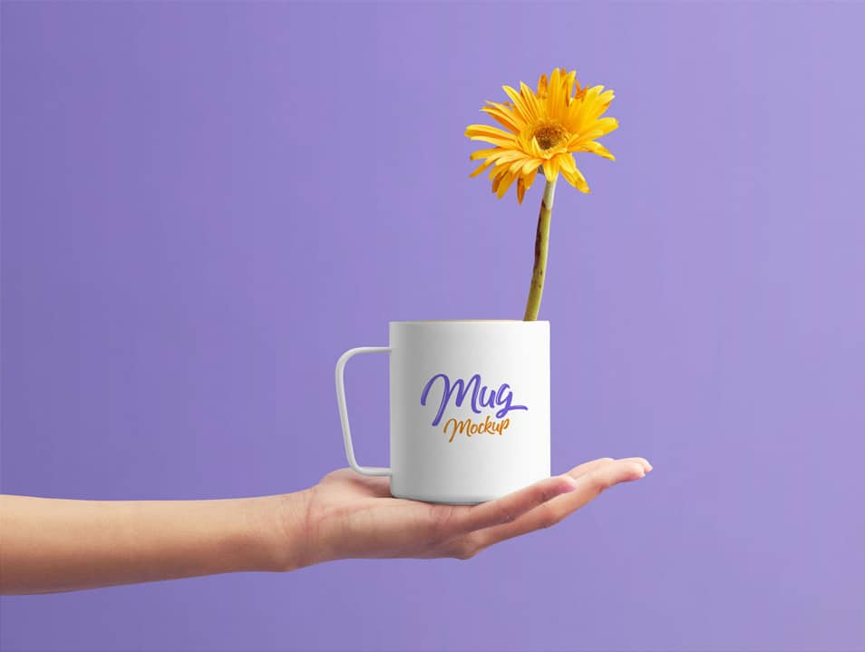 Free Mug on Female Hand Mockup PSD