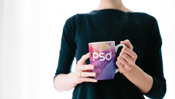 Woman Holding Coffee Mug Mockup PSD