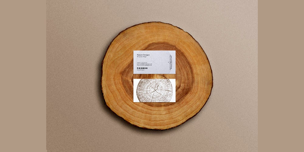Business card mockup on wooden stump
