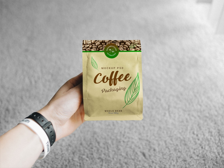 Free Hand Holding Coffee Bag Packaging Mockup PSD