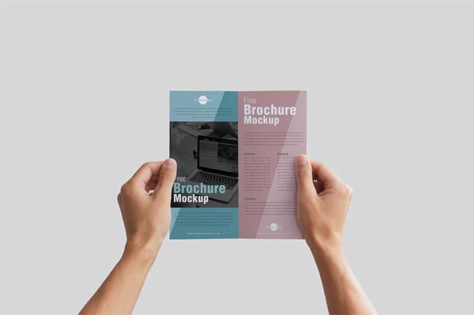 Free Man Holding Brochure in Hands Mockup PSD