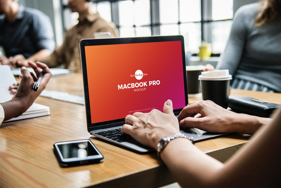 Free Person Using MacBook Pro Mockup PSD