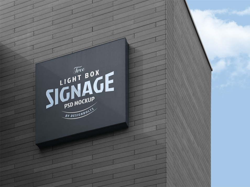 Free Wall Mounted Company Logo Signage Board on Building Mockup PSD
