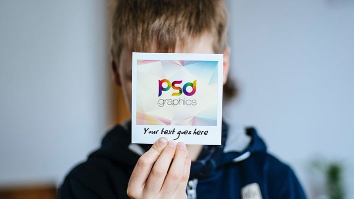 Holding Polaroid Photo Mockup PSD
