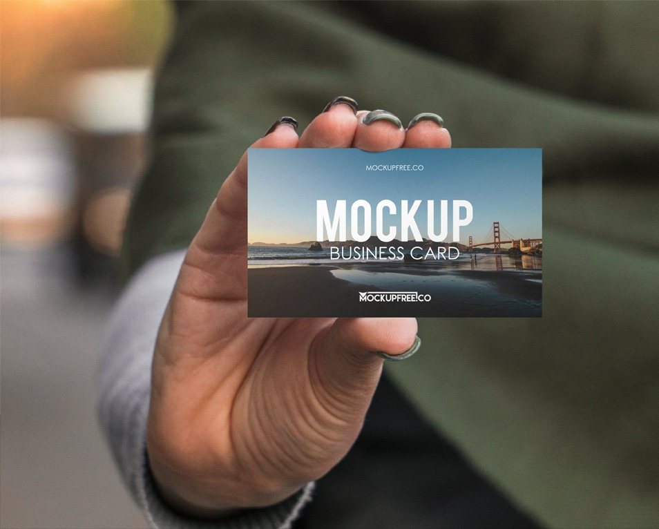 Business Card in Hand Free PSD Mockup