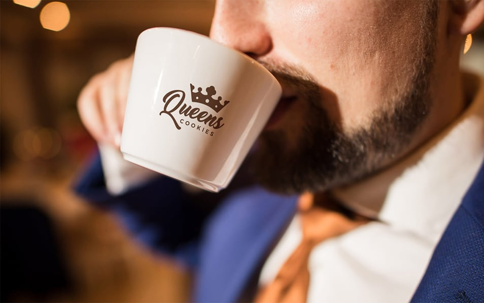 Coffee Cup and a Man in a Suit Free Mockup