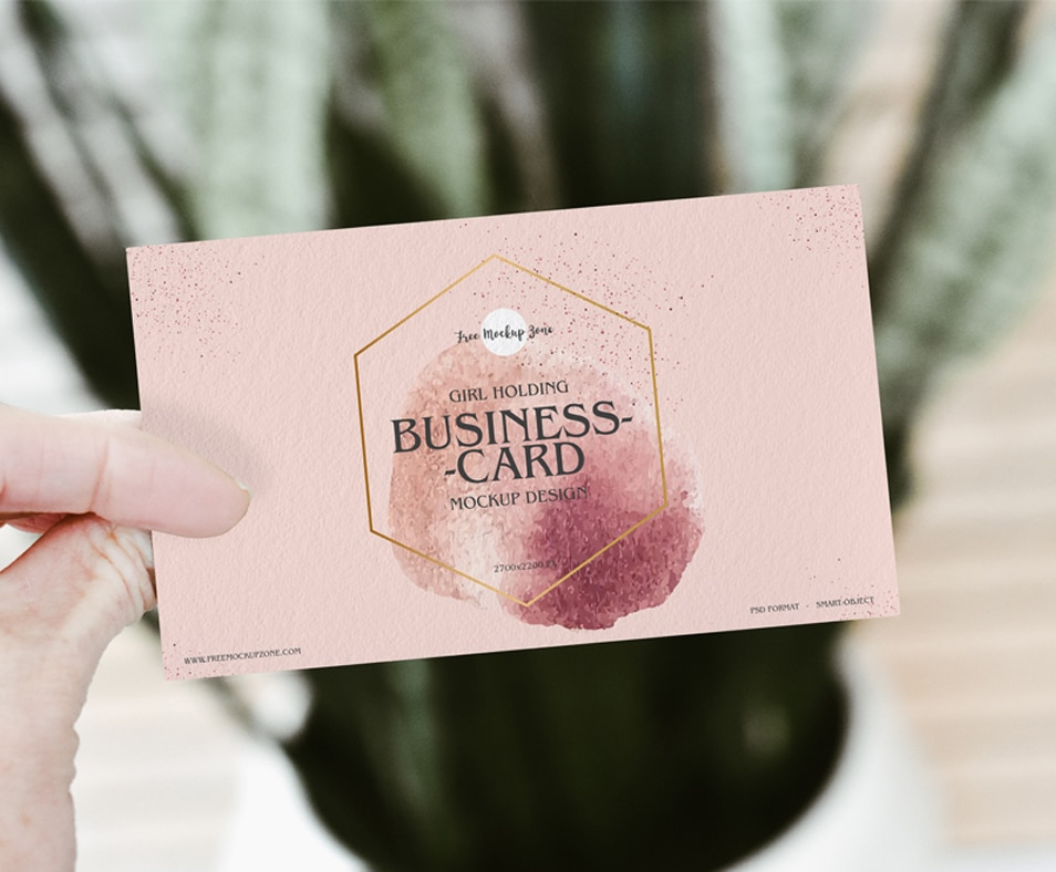 Free Girl Holding PSD Business Card Mockup Design