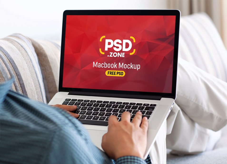 Man Typing on Macbook Pro Mockup PSD