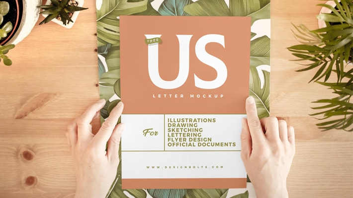 Free Hand Holding White US Letter Paper Mockup PSD