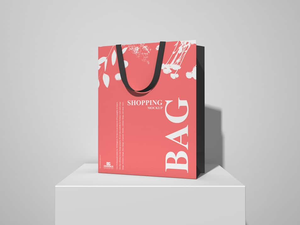 Free Shopping Bag on White Podium Mockup