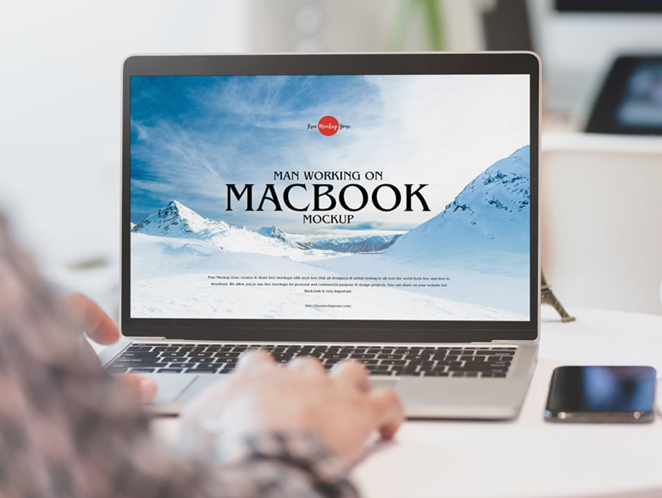 Free Man Working on MacBook Mockup