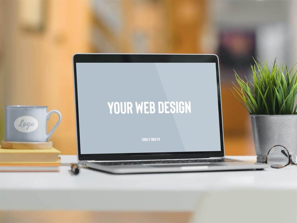 Free Mug & Laptop Website Mockup PSD