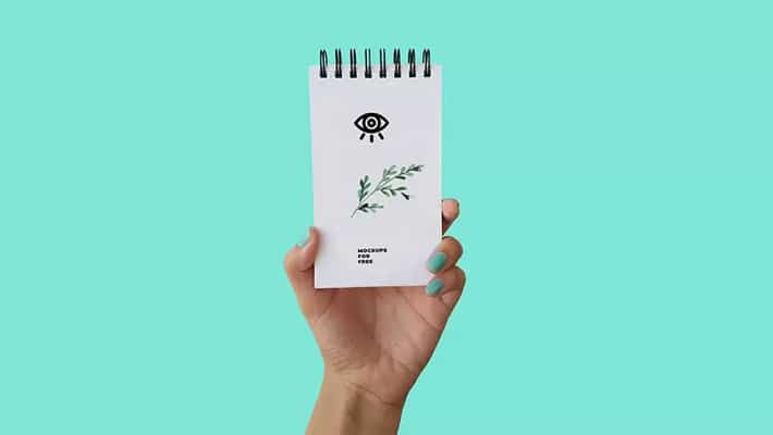 Notepad In Hand Mockup