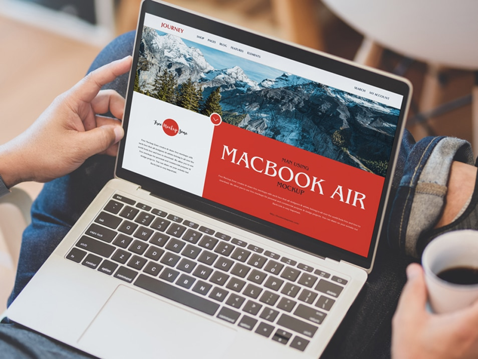 Free Man Using MacBook Air Mockup