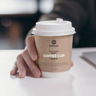 Free Person Holding Kraft Coffee Cup Mockup Design