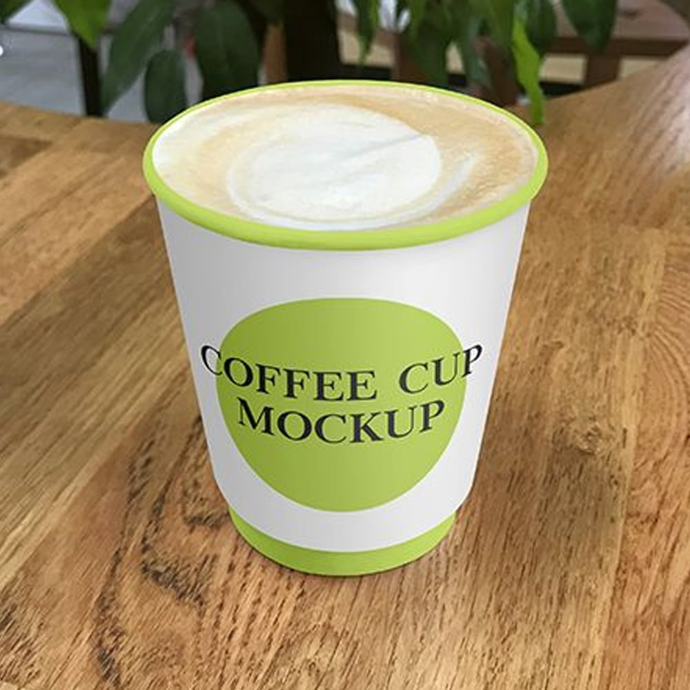 Free Paper Coffee Cup on Cafe Table Mockups
