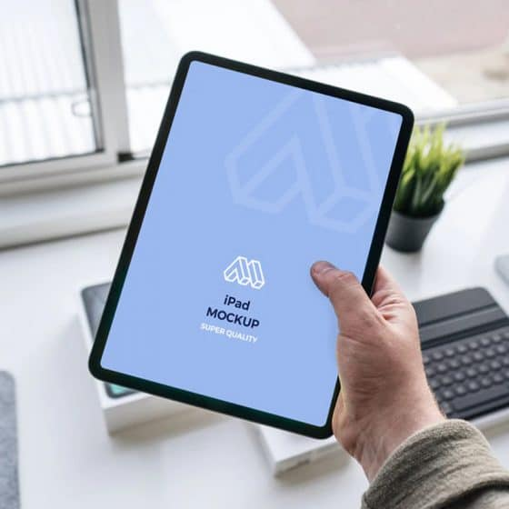 Tablet In Hand Mockup