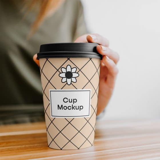 Coffee Cup with Hand Mockup